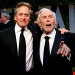FILE PHOTO: Actor Michael Douglas (L) and his father, actor Kirk Douglas, arrive together at the 2009 Vanity Fair Oscar Party in West Hollywood, California February 22, 2009. REUTERS/Danny Moloshok/File Photo
