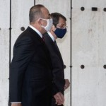 Cypriot President and Greek Cypriot leader Nicos Anastasiades and Turkish Foreign Minister Mevlut Cavusoglu walk before a meeting at the United Nations European headquarters in Geneva, Switzerland April 28, 2021. Stavros Ioannides/PIO/Handout via REUTERS ATTENTION EDITORS THIS IMAGE HAS BEEN SUPPLIED BY A THIRD PARTY